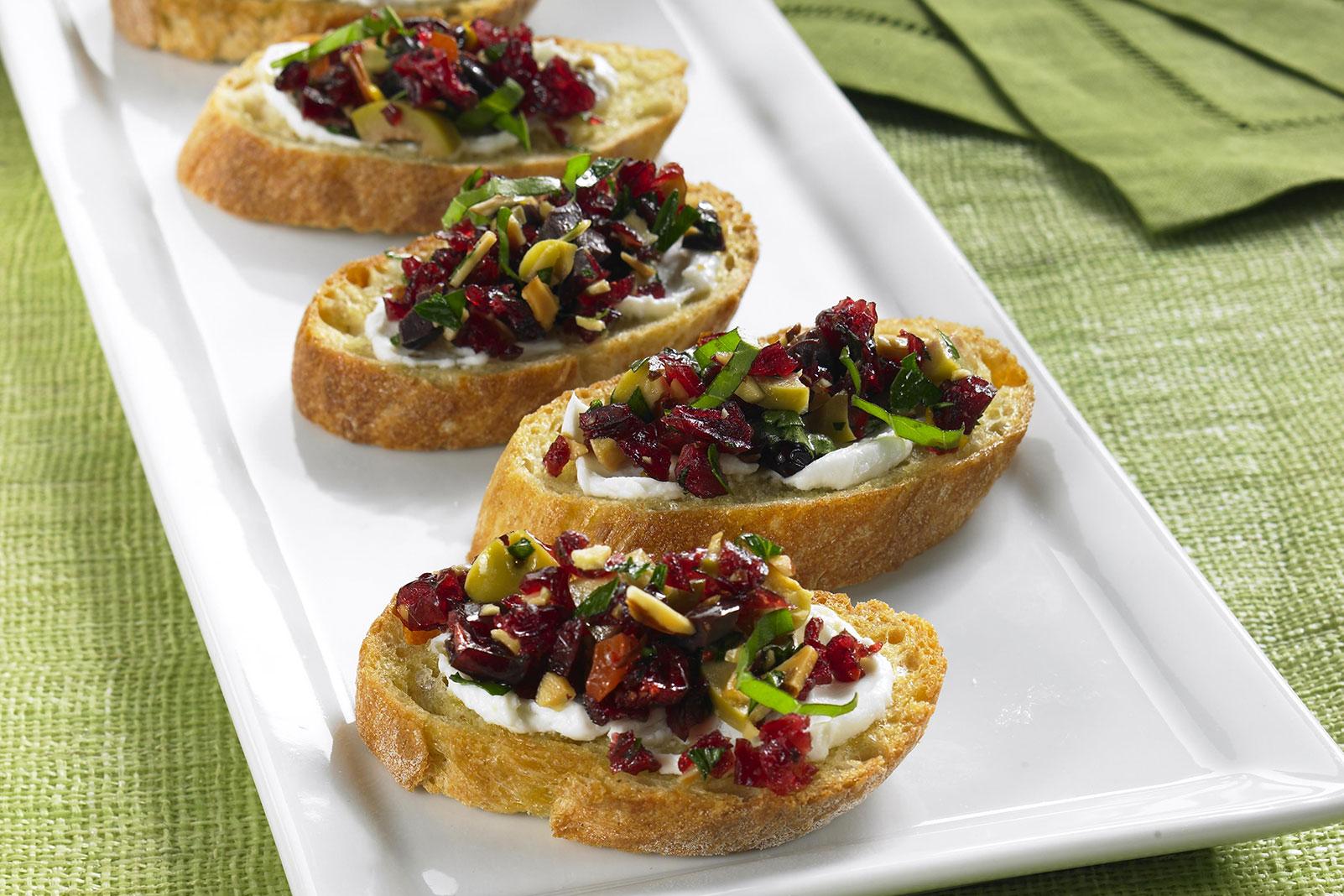 Warm Chevre Crostini with Cranberry Basil Tapenade