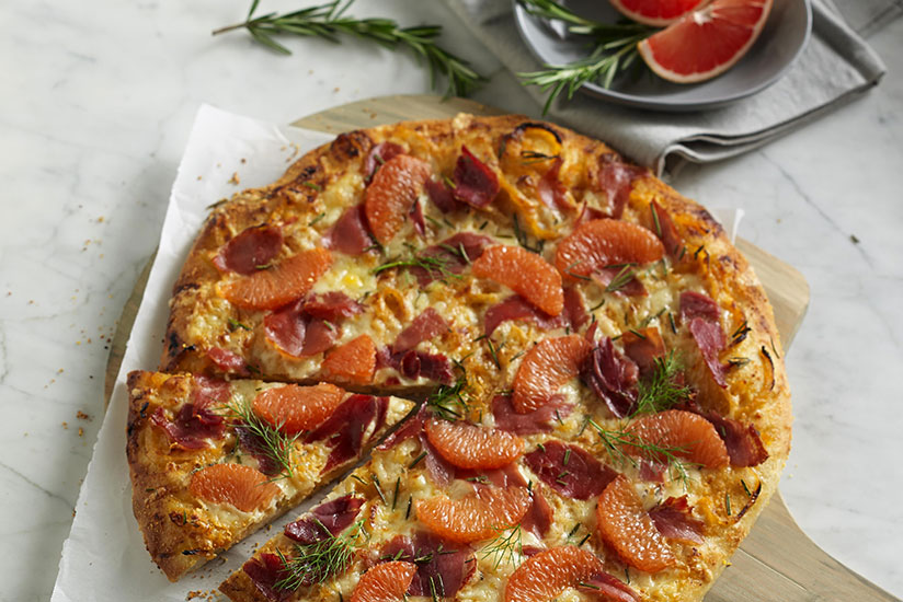 Rosemary Prosciutto Pizza with Spicy Grapefruit Caramelized Fennel and Onio